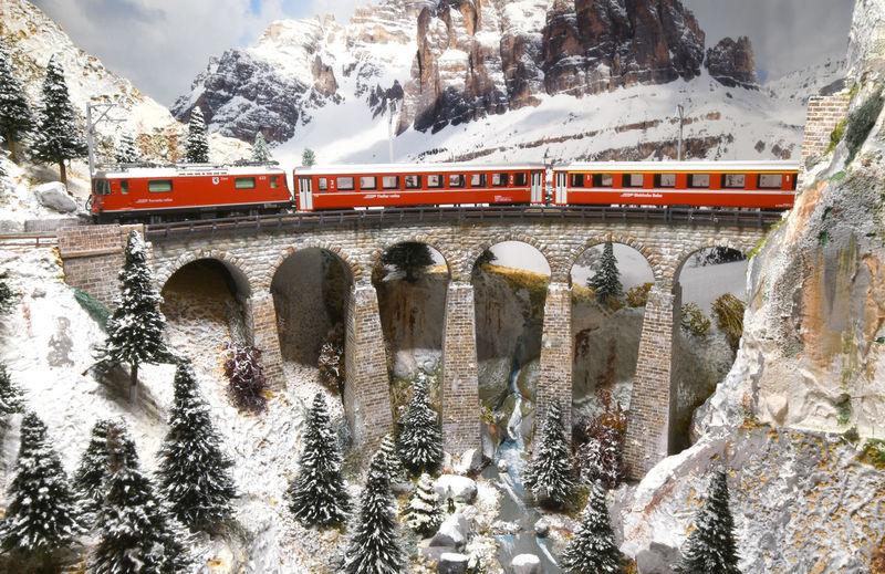 View of train passing through snow covered bridge