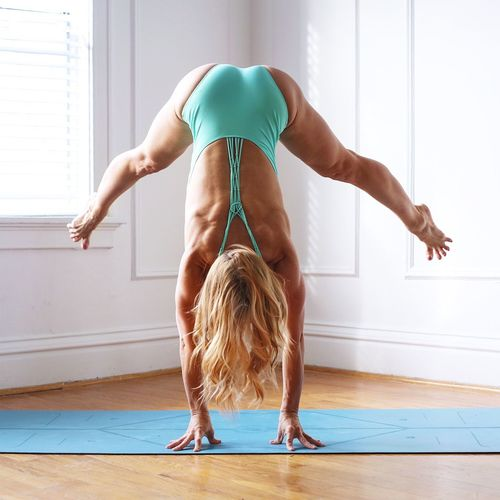 Full Length Of Woman Doing A Handstand