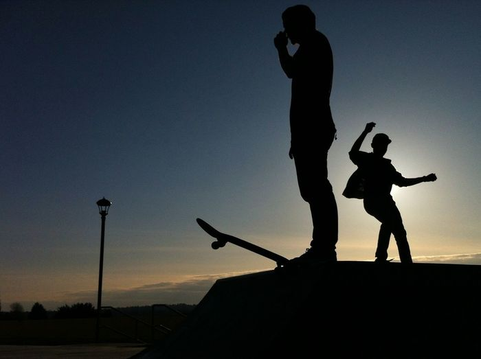 Low angle view of silhouette woman at sunset