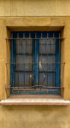 Low angle view of closed window of building