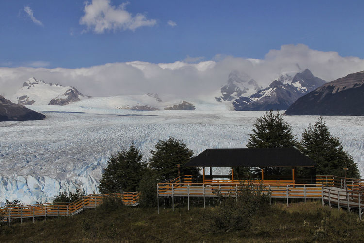 Glaciar Perito Moreno Glacier Perito Moreno. Patagonia. Argentina. Mountain Sky Snow Beauty In Nature Cold Temperature Architecture Built Structure Cloud - Sky Winter Scenics - Nature Nature Building Exterior Mountain Range House Snowcapped Mountain Tree Building Day Tranquility No People Outdoors