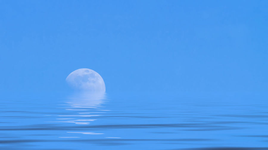 Moon over the blue wide sea Blue Water Sky Moon Nature Tranquility No People Tranquil Scene Sea Scenics - Nature Idyllic Clear Sky Beauty In Nature Copy Space Outdoors Moonlight Ocean