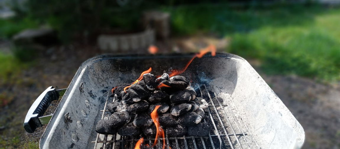 Close-up of fire on barbecue
