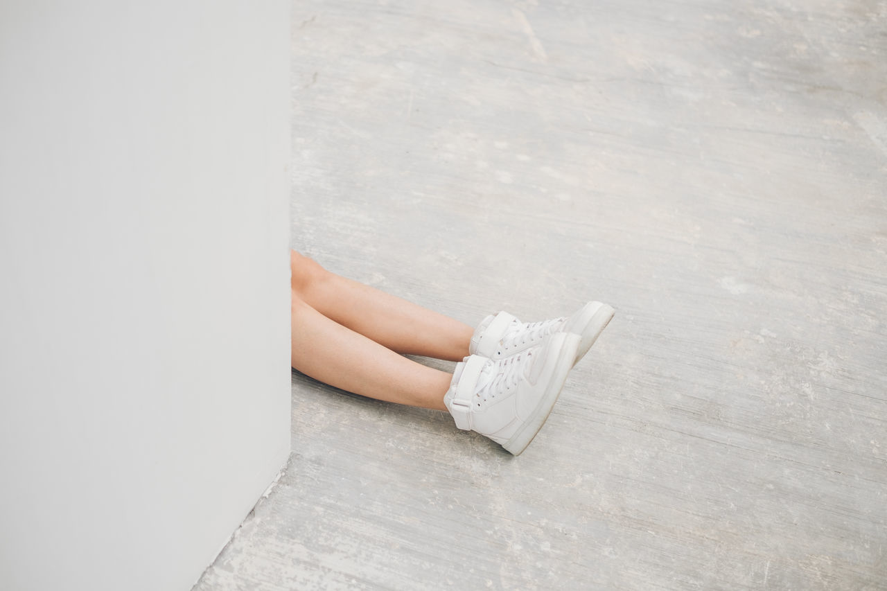 Low section of young woman on the floor