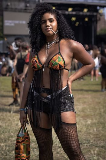 @whosrachaell at AfroPunk Brooklyn 2018 Kente Cloth African Print Melanin One Person Looking At Camera Three Quarter Length Front View Young Adult Young Women Focus On Foreground One Person Looking At Camera Three Quarter Length Front View Young Adult Young Women Focus On Foreground Portrait Hair Clothing Incidental People Standing Hairstyle Women Lifestyles Leisure Activity Music Real People Beauty Beautiful Woman