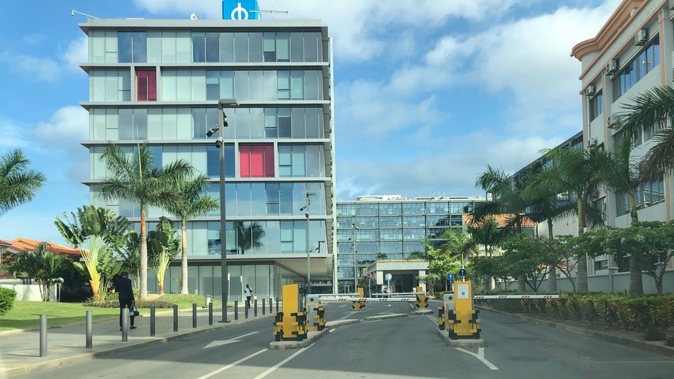Cidade Financeira #angola #cidadefinanceira Sky Building Exterior City Cloud - Sky Architecture Tree Built Structure Incidental People Sunlight Residential District Street Outdoors Transportation Building Sign Plant Motor Vehicle Road Day Nature