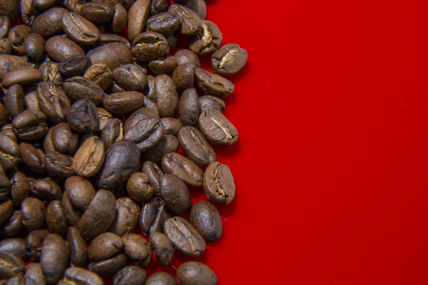 The Roasted Coffee Beans red background macro close up image for coffee background. Roasted Coffee Beans Coffee Beans Baker Coffee Beans Roasted Close-up Coffee Bean Coffee Beans Coffee Beans For Sale Coffee Beans Roaster Food Food And Drink Freshness Healthy Eating Indoors  Large Group Of Objects No People Raw Coffee Bean Red Roasted Roasted Coffee Roasted Coffee Bean Still Life