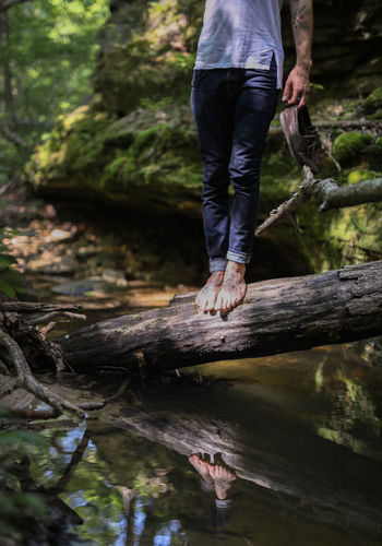 Backgrounds Barefoot Close-up Day Human Leg Leisure Activity Lifestyles Low Section Men Nature One Person Outdoors Real People Reflection Rock - Object Standing Tree Water