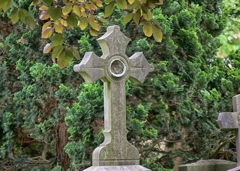 Cemetery Cemetery Close-up Cross Cross Day Grave Memorial No People Outdoors Religion Spirituality Stone Cross Tombstone Tree
