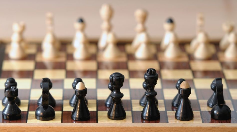 Full frame shot of chess pieces on board