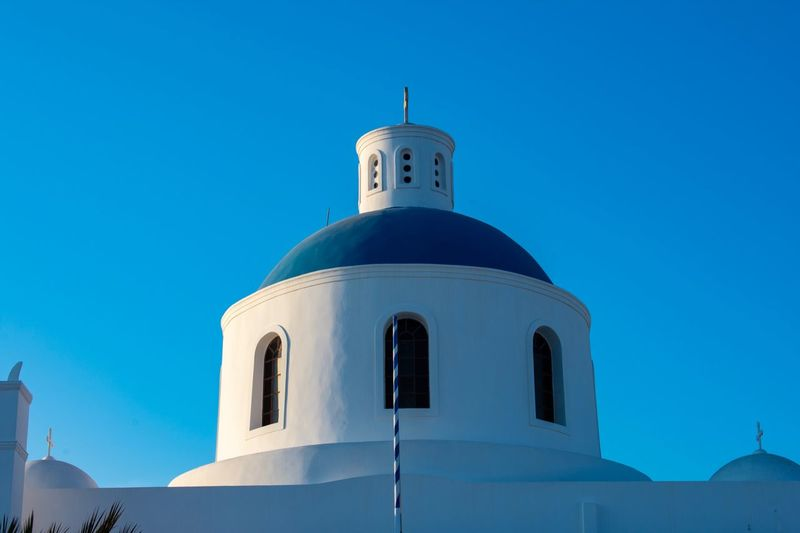 Christian church in Santorini Capture Tomorrow EyEmNewHere Eyemphotography Christianity Church EyeEm Selects Blue Sky Clear Sky Building Exterior Architecture Low Angle View Place Of Worship Religion Built Structure Tower Belief No People Building Nature Spirituality Dome Copy Space Day