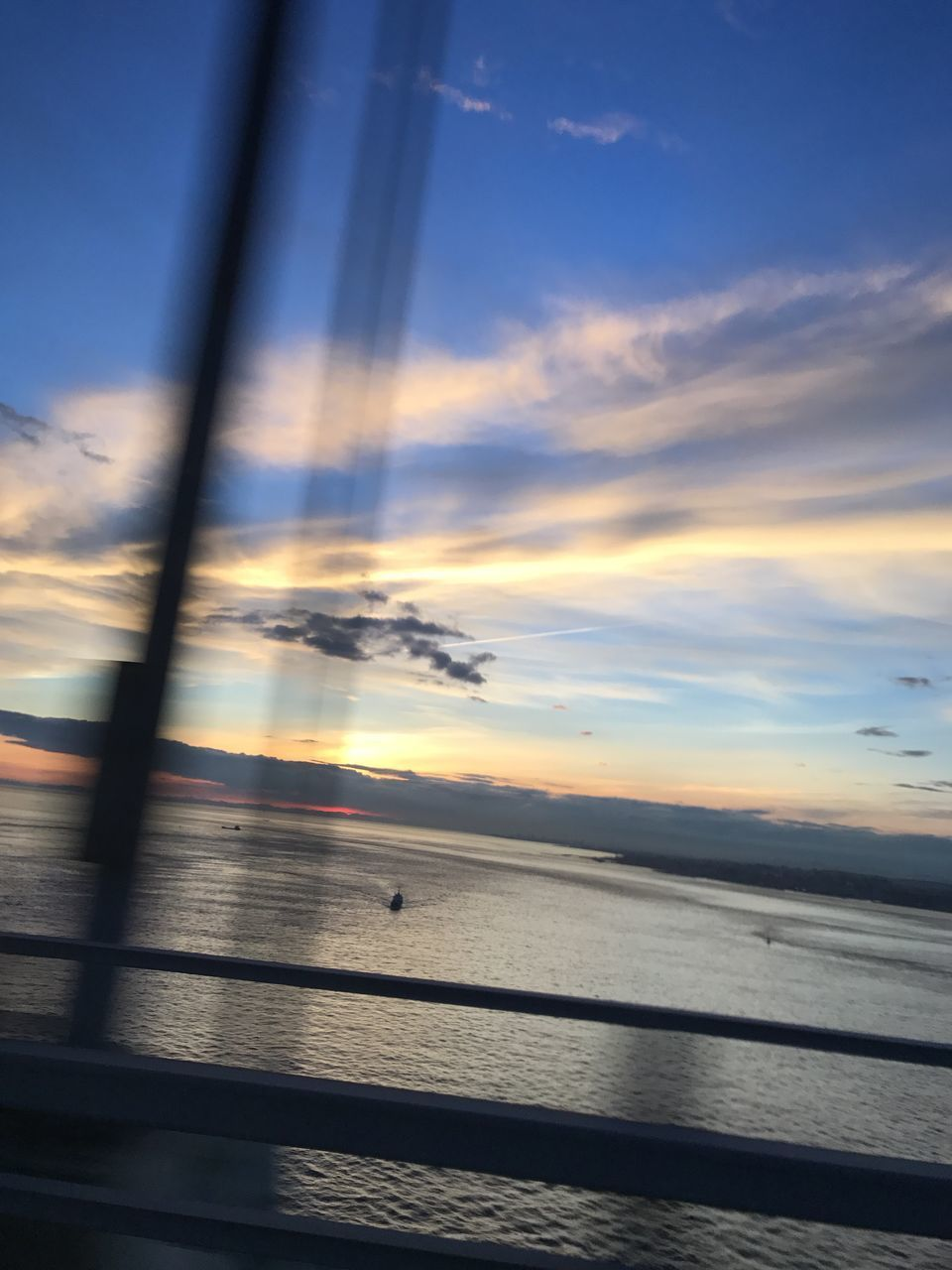 BLURRED MOTION OF SEA AGAINST SKY AT SUNSET