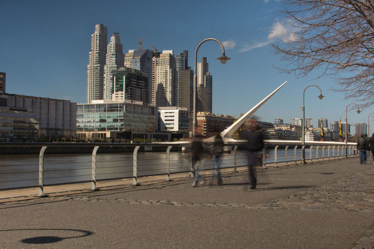 Architecture Bridge - Man Made Structure Buenos Aires, Argentina  Building Exterior Built Structure City Life Clear Sky Modern Motion Motion Blur Outdoors Puente De La Mujer Skyscraper Tourism Travel Destinations Walkway Water Adapted To The City