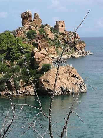 Water Sea Cliff Beach Old Ruin Rock Face Rock - Object Sky Architecture Building Exterior