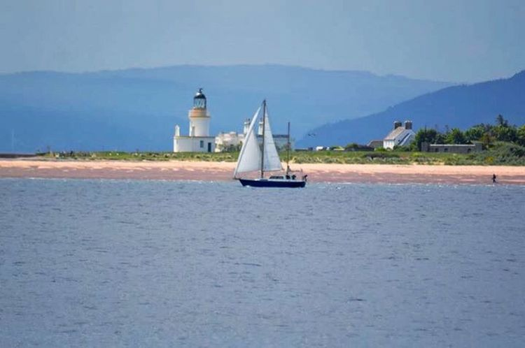 Sailboat Sea Water Nautical Vessel Sailing Lighthouse Beach Day Outdoors Travel Destinations Built Structure Sailing Ship Sky Yachting Nature Yacht Scottish Highlands Moray Firth Scotland