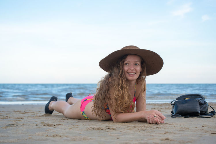 Adult Beach Beautiful Woman Clothing Hair Hairstyle Happiness Hat Horizon Over Water Land Leisure Activity Lifestyles Looking At Camera One Person Outdoors Portrait Sea Sky Smiling Sun Hat Vacations Water