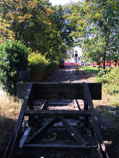 View from buffer towards a train Buffer Stop Day Nature Outdoors Station Platform Terminus Train Vehicle Wood - Material