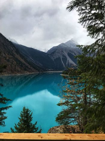 Lake Blue Tree Water Mountain Cloud - Sky Lake Plant Beauty In Nature Sky Tranquil Scene Scenics - Nature Tranquility Nature Day No People Non-urban Scene Reflection Mountain Range Environment Outdoors Coniferous Tree