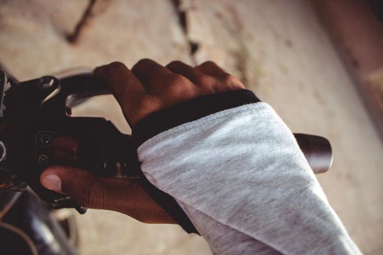 Cropped hand riding motor bike