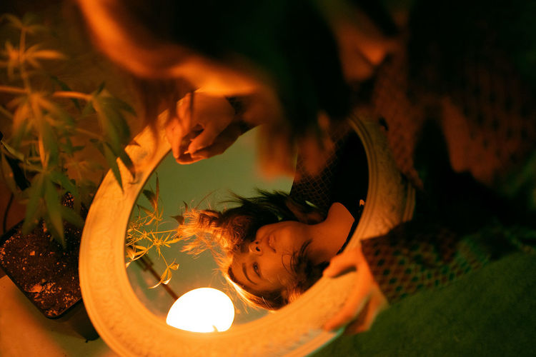High angle view portrait of girl lying on fire