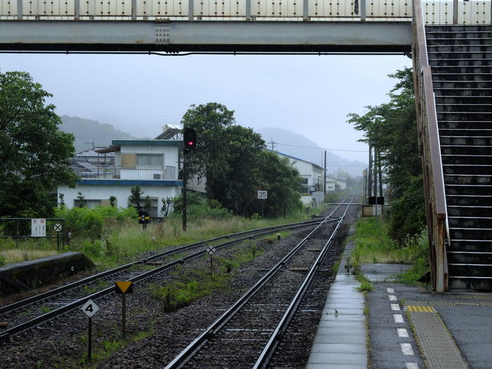 Rainy Days Rightside Train Platform Railroad Railway Perspective Vanishing Point Lines Footbridge TOWNSCAPE Cloudy Mountains Travel Photography From My Point Of View 電車旅 雨の日 EyeEm Best Shots No Filter/no Edit