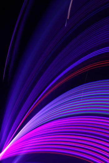 Full frame shot of multi colored lights against black background