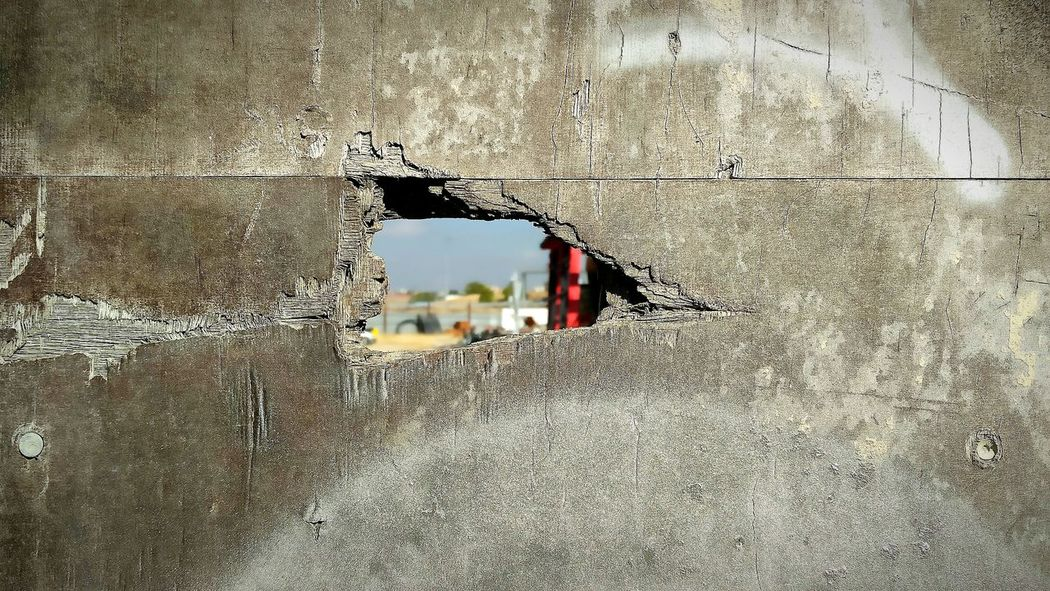 Hole in the Wall Architecture Street Wall - Building Feature Close-up Surface Level Day No People Deterioration Wall Concrete Plywood Panel Outdoors