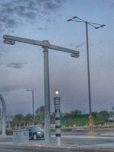 Street light by road against sky
