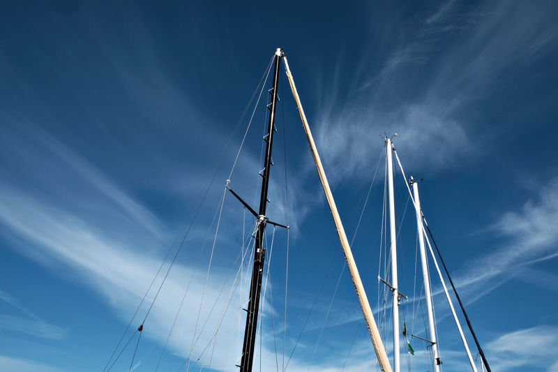 Low Angle View Of Masts Against Blue Sky