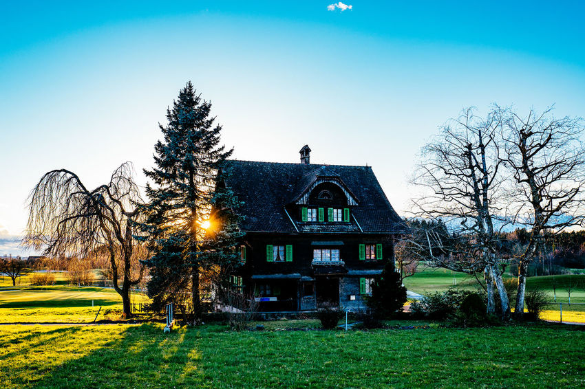 Architecture Bare Tree Blue Building Exterior Built Structure Clear Sky Field Gormund Grass Grassy Green Color Growth House Kapelle Landscape Lawn Nature Outdoors Sky Sunlight Tranquility Tree