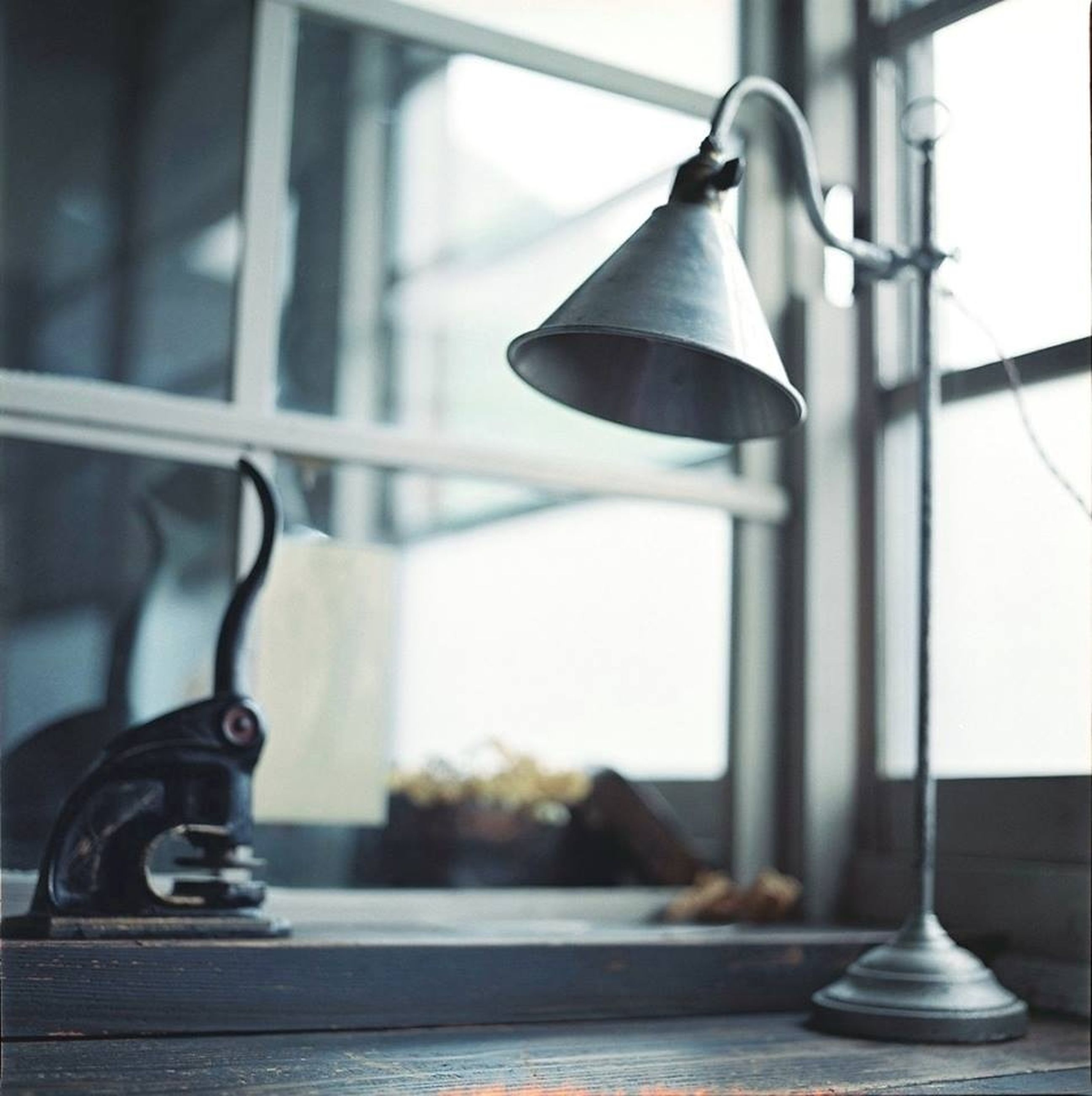 indoors, metal, focus on foreground, close-up, metallic, hanging, handle, still life, no people, absence, day, lighting equipment, old-fashioned, selective focus, sunlight, home interior, empty, railing, table, shadow