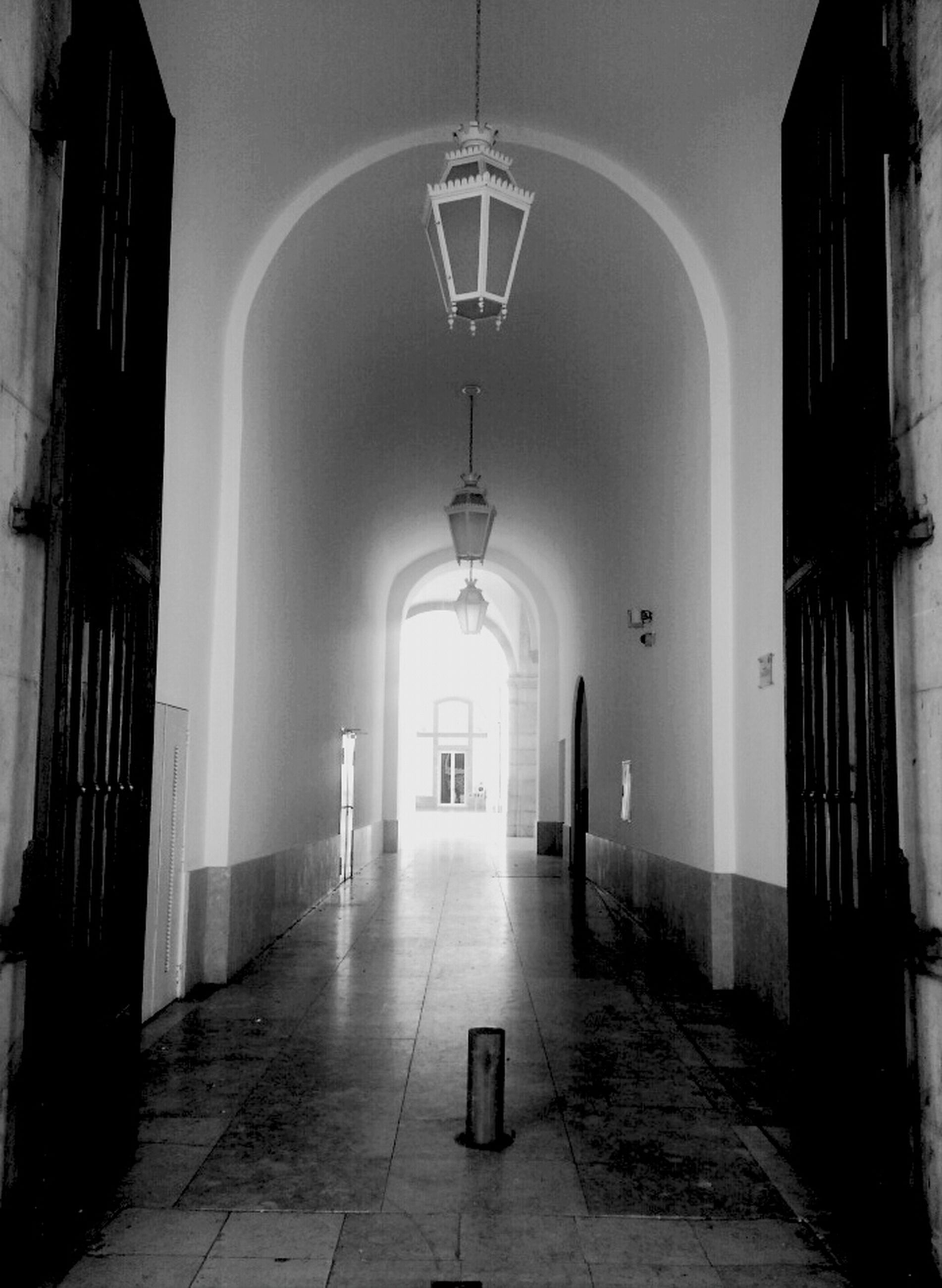 architecture, built structure, indoors, the way forward, corridor, arch, empty, lighting equipment, tiled floor, ceiling, illuminated, door, absence, flooring, entrance, building exterior, building, narrow, wall - building feature, walkway