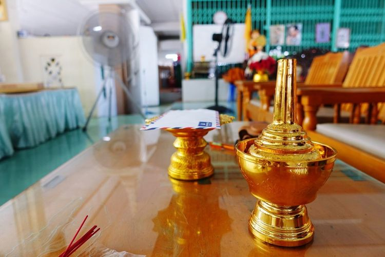 For pour water to merit Temple Merit Pray Gold Table Close-up Bhudist