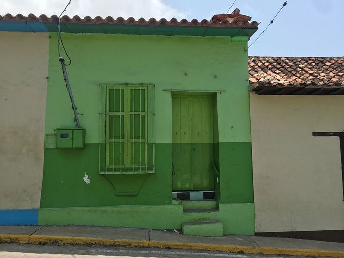 Day House Built Structure Architecture Building Exterior Door Green Color No People Roof Outdoors Tiled Roof  Choroni_Vnzla Choroni Town Architecture Colonial Style Caribbean Architecture Colonial Architecture