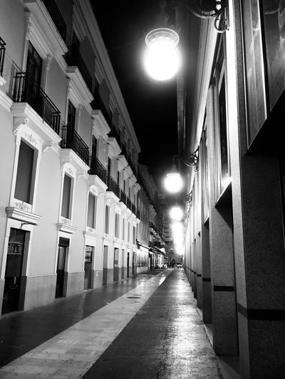 Empty Street Architecture Built Structure Lighting Equipment The Way Forward Building Exterior Direction Illuminated Building Street Street Light City No People Night In A Row Residential District Empty Electric Light Diminishing Perspective