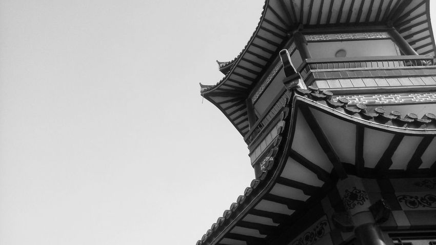 Architecture Low Angle View Built Structure Tradition Travel Destinations Outdoors Sky No People Temple Pagoda Day China Black And White Sightseeing Pagoda Temple Traditional Architecture Tranquility Tourism Architecture Chinese Style Clear Sky Tower