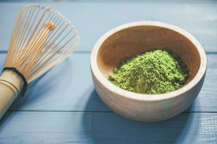 Organic Green Matcha Tea in a Bowl Matcha Tea Tea Food And Drink Green Tea Indoors  Green Color No People Wood - Material Tea Ceremony Ceremony Close-up Freshness Table Still Life Food High Angle View Bowl Drink Purity Place Mat