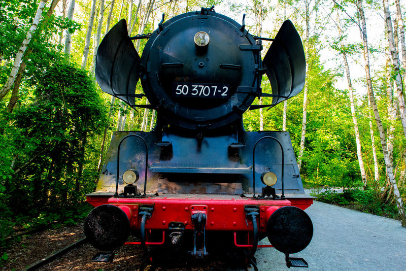 Old Steam Locomotive Black Day Engine Forest Green Color Large Large Machinery Loco Locomotive Machine Machinery Close Up Metal Mode Of Transport No People Old Train Outdoors Red Steam Locomotive Steam Train Steel Train Train - Vehicle Transportation Transportation Tree