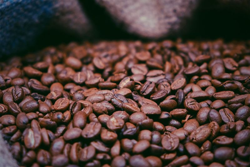 Close-up of roasted coffee beans in sack
