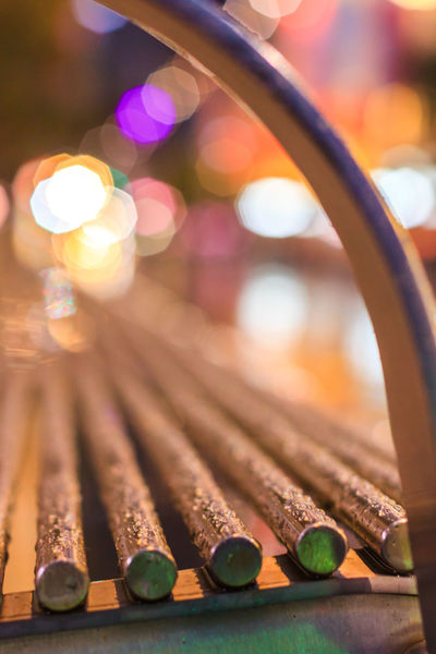 Close up of a metal bench Bench Abundance Arts Culture And Entertainment Close-up Day Focus On Foreground Illuminated In A Row Indoors  Large Group Of Objects Metal Music Musical Instrument No People Safety Selective Focus Stack Still Life Table Wood - Material