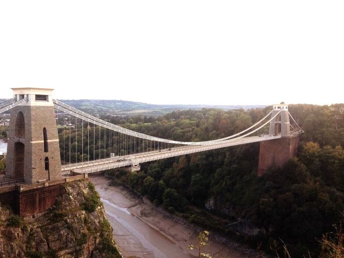 Clifton suspension bridge Connection Bridge - Man Made Structure Travel Travel Destinations Built Structure Architecture River Suspension Bridge Sky Outdoors Day Tree Mountain Nature No People Suspension Construction Structure Engineering Civil Amazing Architecture Riverside Tranquility EyeEmNewHere EyeEmNewHere EyeEmNewHere The Great Outdoors - 2017 EyeEm Awards