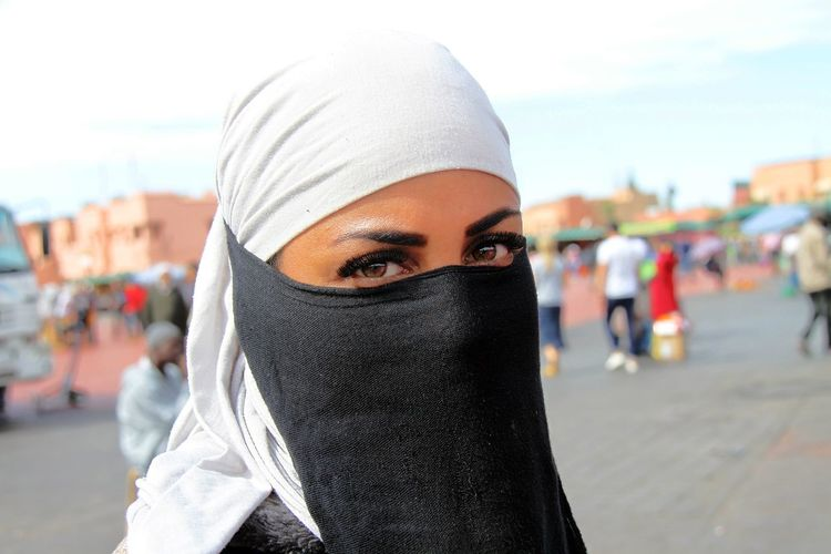 Just for your Eyes - Marrakech Medina Burka  Citylife MoroccoTrip Marrakech Medina, Morocco Marrakesh❤ Streetphotography Streetlife Arabic Style Arabianwoman Maroccanwomen Eyeemprotrait Eyeempopularphotos One Person Portrait Young Adult Focus On Foreground Close-up Looking At Camera Headshot City Incidental People Day Unrecognizable Person Adult Disguise Architecture Obscured Face Front View Clothing Street City Life Hood - Clothing