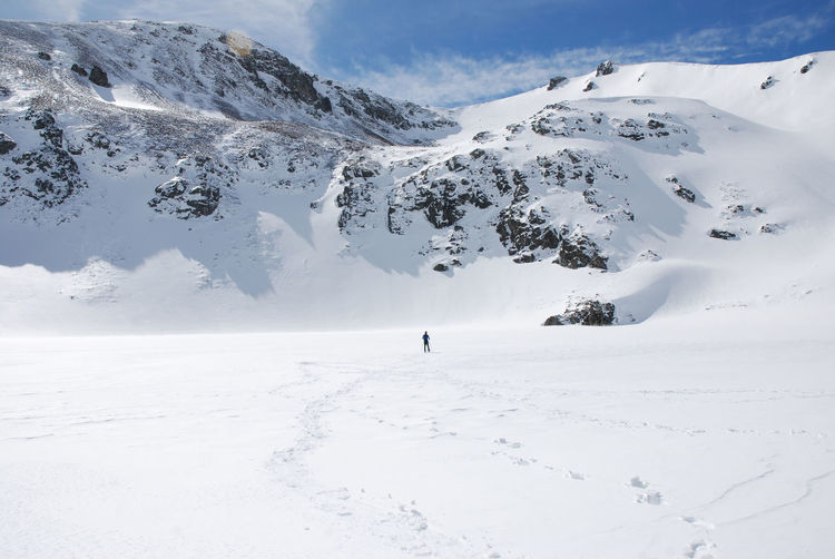 Scenic view of snow covered mountains and frozen lake