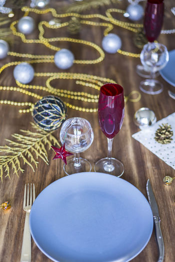Christmas or Thanksgiving table setting on wooden table Champagne Christmas Dinner Gold Holidays New Year Table Setting Thanksgiving Champagne Flute Christmas Decoration Decoration Dinner Table Drinking Glass Food And Drink Glass No People Silver  Table Thanksgiving Dinner Wineglass