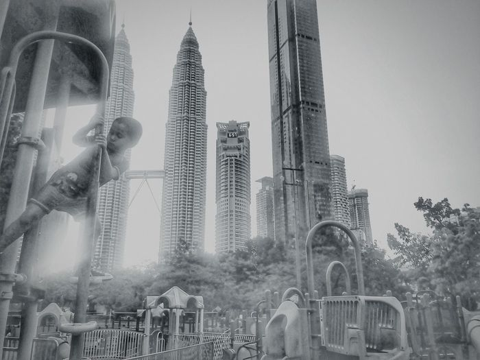 Del climbing the towers Malaysia Delafonte Playground World Traveler 4yo Autism Skyscraper Sky Architecture Building Exterior Built Structure