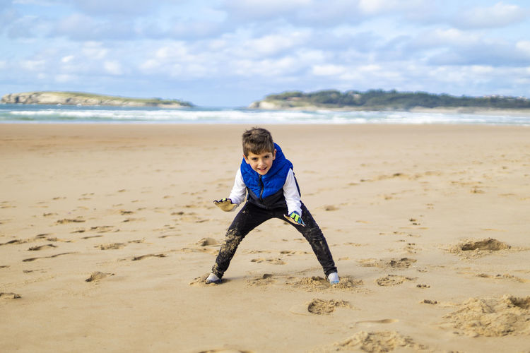 Alone Background Ball Beach Beautiful Boy Caucasian Child Childhood Copy Space Cute Face Football Fun Game Globes Goalie Goalkeeper Happiness Happy Healthy Joy Kid Life Lifestyle Little People person Play Player Playing Portrait Sand Small Smile Soccer Sport Summer Vacation White Young