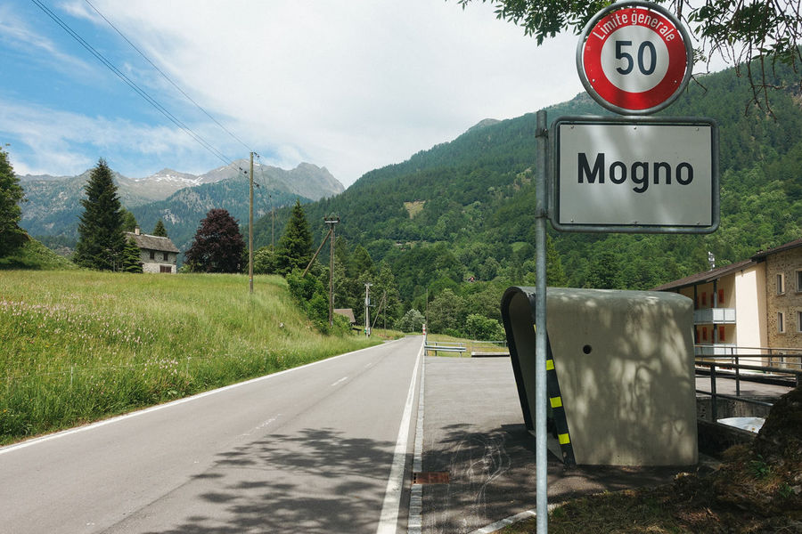 Architecture Botta Mario Botta Mogno Travel Travel Photography Communication Day Direction Guidance Information Information Sign Mountain Nature No People Outdoors Plant Road Road Sign Sign Sky Switzerland Symbol Text The Way Forward Transportation Tree Western Script