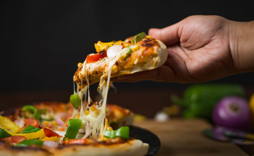 Food And Drink Food Human Hand Hand One Person Human Body Part Freshness Pizza Indoors  Body Part Ready-to-eat Real People Holding Unrecognizable Person Vegetable Lifestyles Finger Human Finger Selective Focus Human Limb Preparing Food