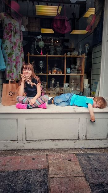 Outside a Charity shop in Plymouth (UK), my kids catch a quick break while their mother goes in. Kids Plymouth Plymouthbarbican Break Shopping Summer Colour Holiday