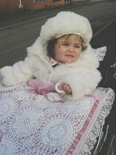 Cute girl in baby carriage